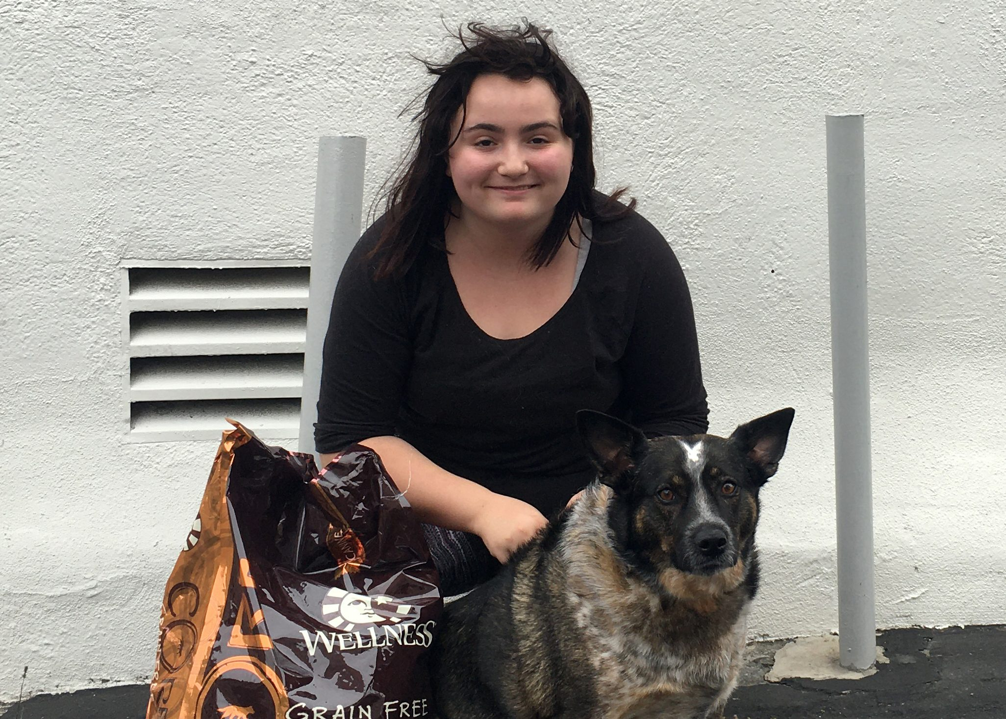 Ashlyn & Cleo smiling after receiving dog food provided by K9 Connection & the NKLA Coalition for Shelters & Rescues!